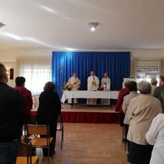 Monsignor d'Ascenzo in visita alla scuola San Paolo