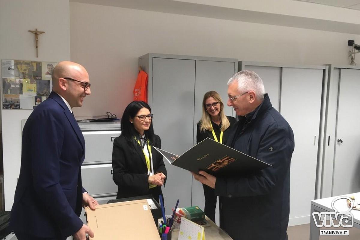 Monsignor D'Ascenzo in visita alla Poste