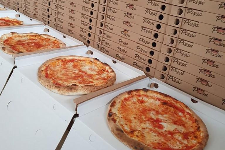 Pizze donate a Trani