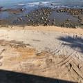 Lavori per il ripascimento del litorale allo Scoglio di Frisio